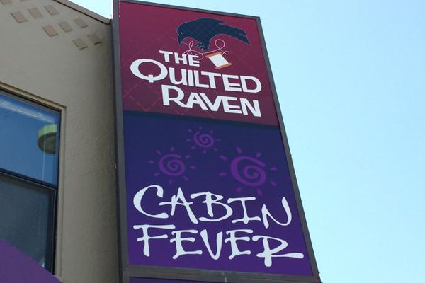 Quilted Raven Sign Face